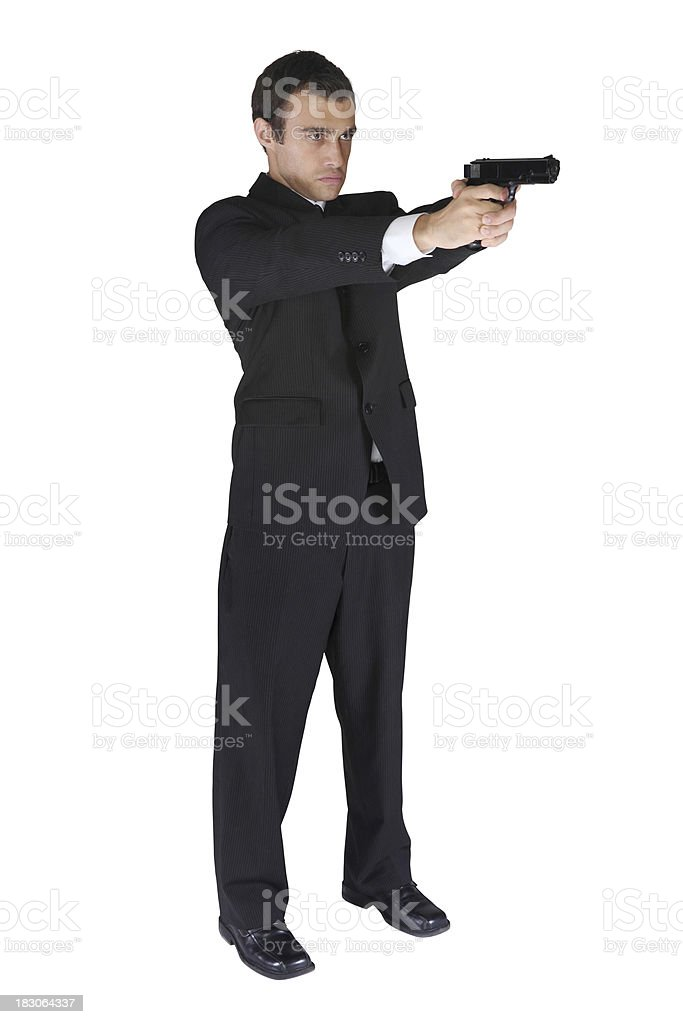 Isolated man in suit with a handgun stock photo