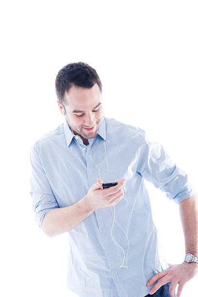 Isolated Man on White Looking at MP3 Player stock photo