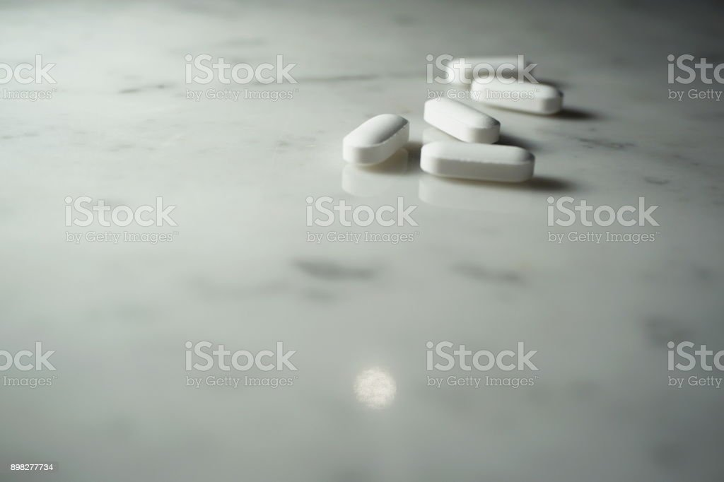 Isolated medicine on white marble stock photo