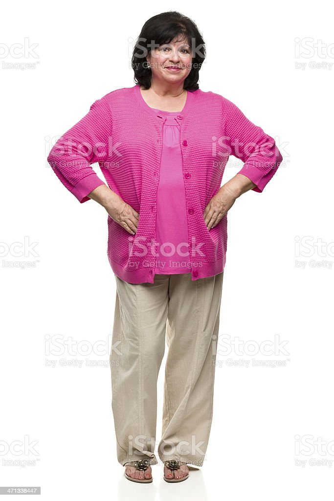 Isolated middle aged woman in a pink shirt and tan pants stock photo