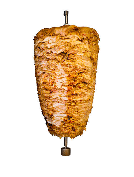 Isolated Middle East Grilled Chicken Kebab Meat Grilled skewered chicken on spit, a traditional meat shaved, served inside kebab sandwich in Mediterranean and Arab countries in Middle East, cooked isolated on pure white background spit roasted stock pictures, royalty-free photos & images