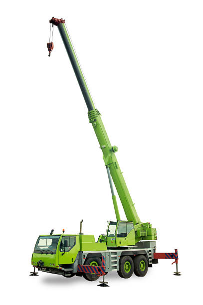 Isolated mobile crane Mobile crane with lifting boom up mobile crane stock pictures, royalty-free photos & images