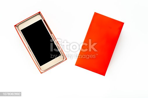 1161116588istockphoto Isolated mobile phone, box with smartphone with black screen and touch display, wireless device concept 1078062892