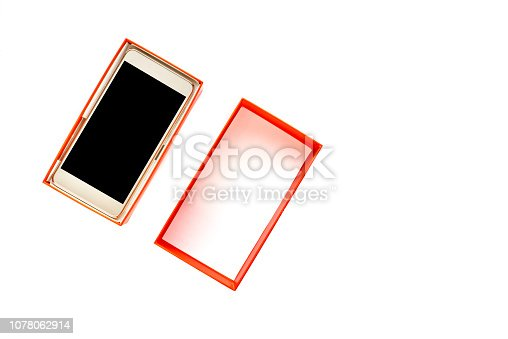 1161116588istockphoto Isolated mobile phone, gift box with smartphone with black screen and touch display, wireless technology concept 1078062914