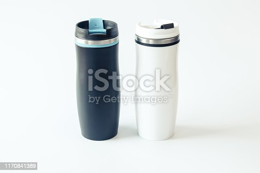 1129148925istockphoto Isolated. Mockup. Black and white metal travel mugs with a place for your design. Close up. 1170841389