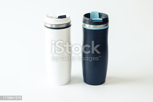 1129148925istockphoto Isolated. Mockup. Black and white metal travel thermoses with a place for your design. 1170841375