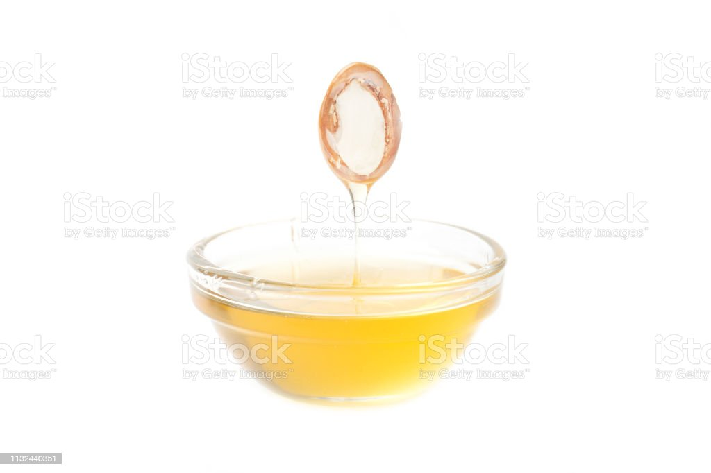 ARGAN SEEDS isolated on a white background. Argan oil and argan nuts concept stock photo