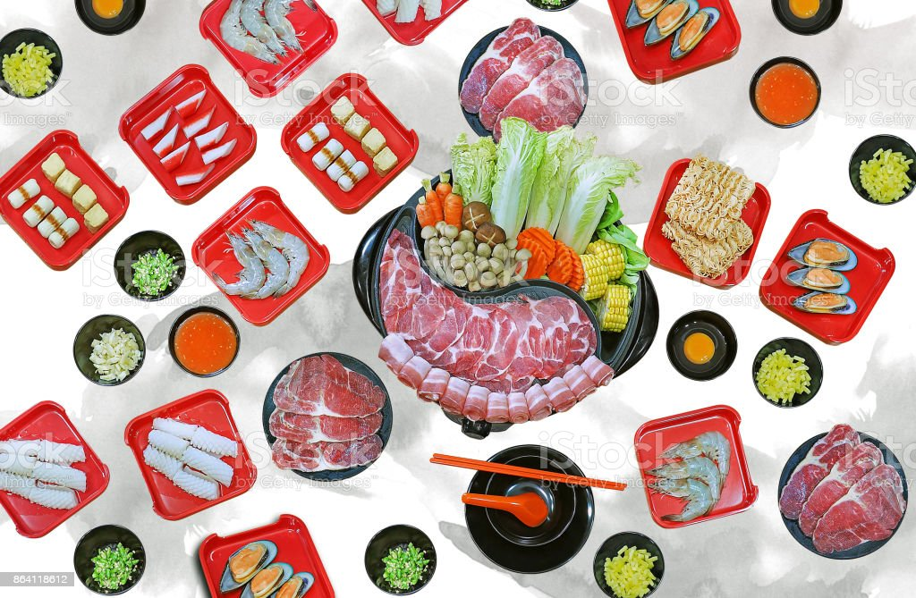 isolated on white background with clipping path - assort many of Suki yaki shabu set on hot pot, pork, beef, mussel, squid, egg, shrimp, fish ball view from top royalty-free stock photo