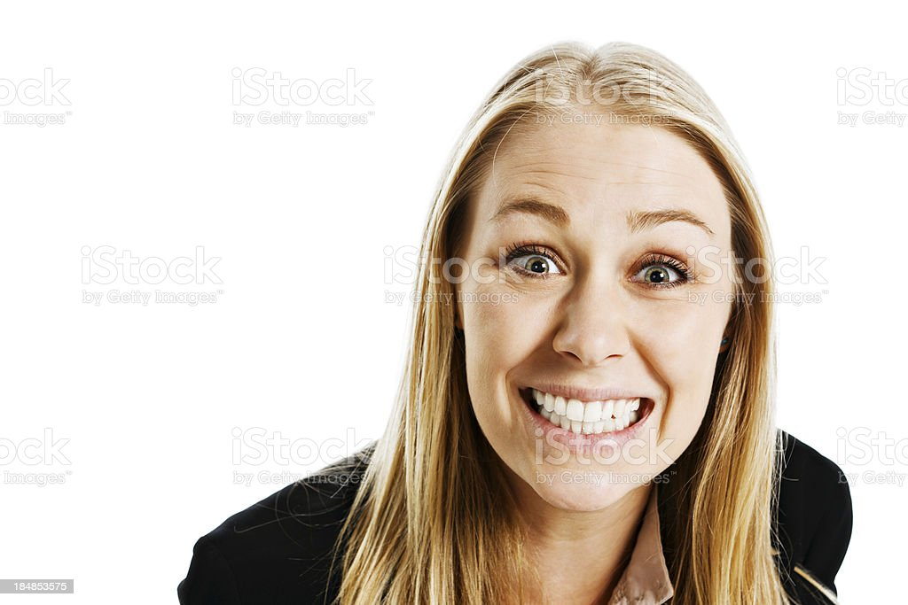 Isolated on white, cute young blonde gives toothy smile royalty-free stock photo