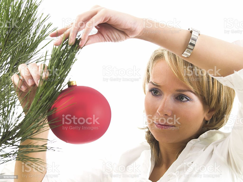 isolated on white young woman with christmas bauble royalty-free stock photo