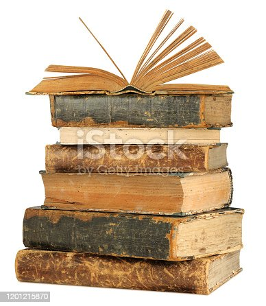 Isolated books. Open book on top of old books stack isolated on white background with clipping path