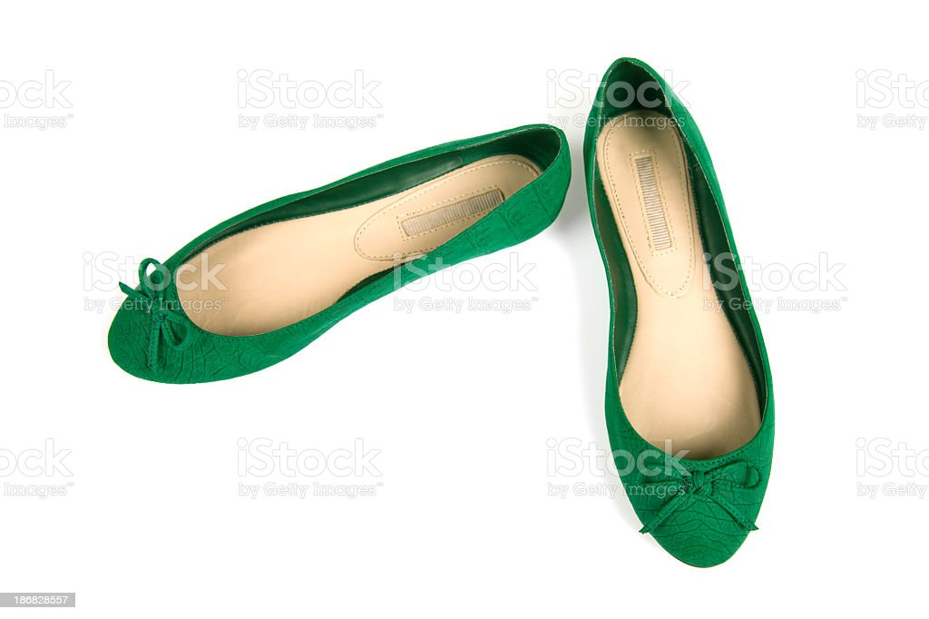 Isolated pair of green flat shoes with bow stock photo