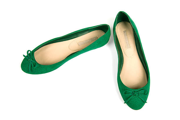 isolated pair of green flat shoes with bow - shoe stock photos and pictures