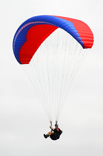 Isolated Paraglider  paragliding stock pictures, royalty-free photos & images