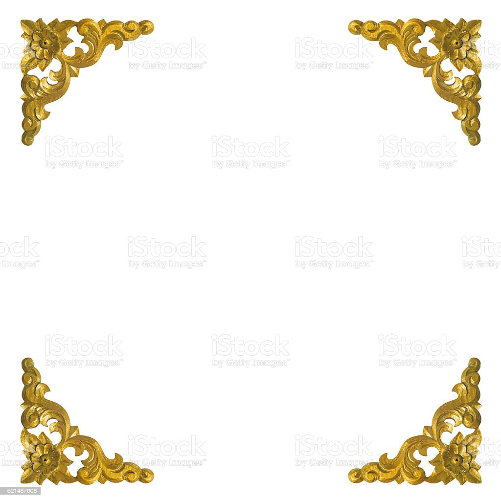Isolated pattern of wooden carve gold paint on white background photo libre de droits
