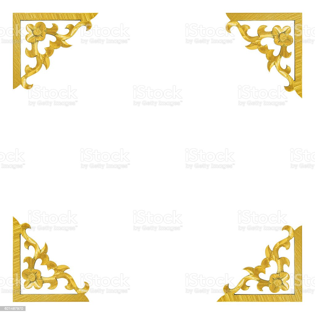 Isolated pattern of wooden carve gold paint on white background foto stock royalty-free