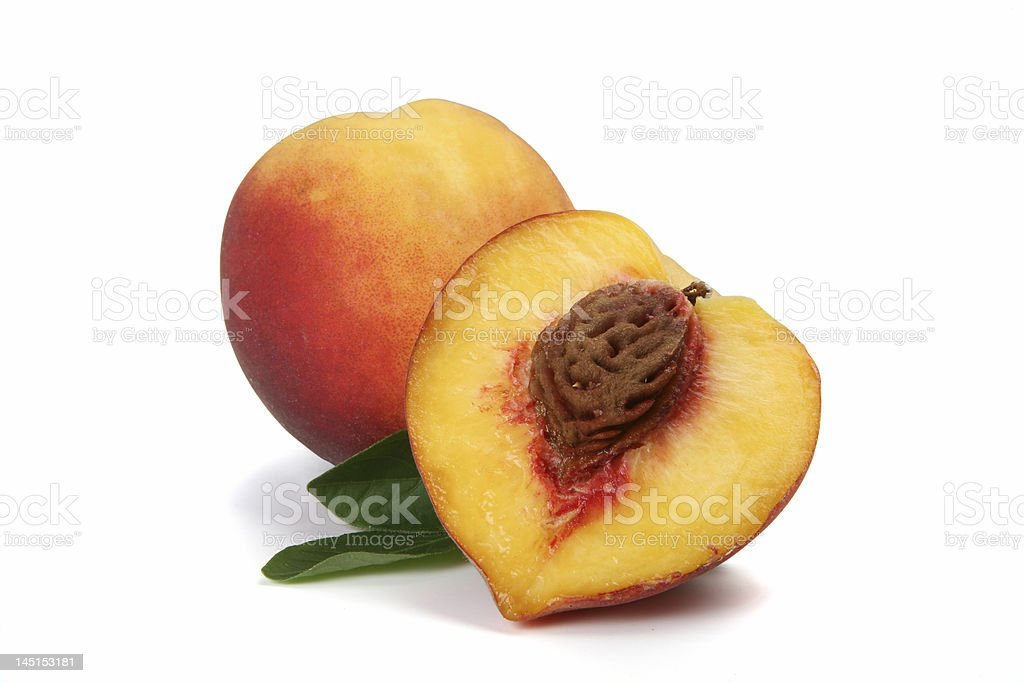Isolated peach cut in two halves royalty-free stock photo
