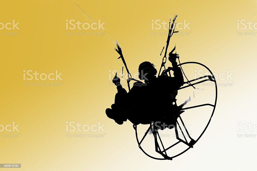 Isolated person paragliding stock photo