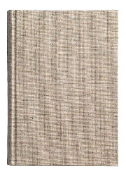 Isolated photo of a fabric covered book cover Blank Book on white background. hardcover book stock pictures, royalty-free photos & images