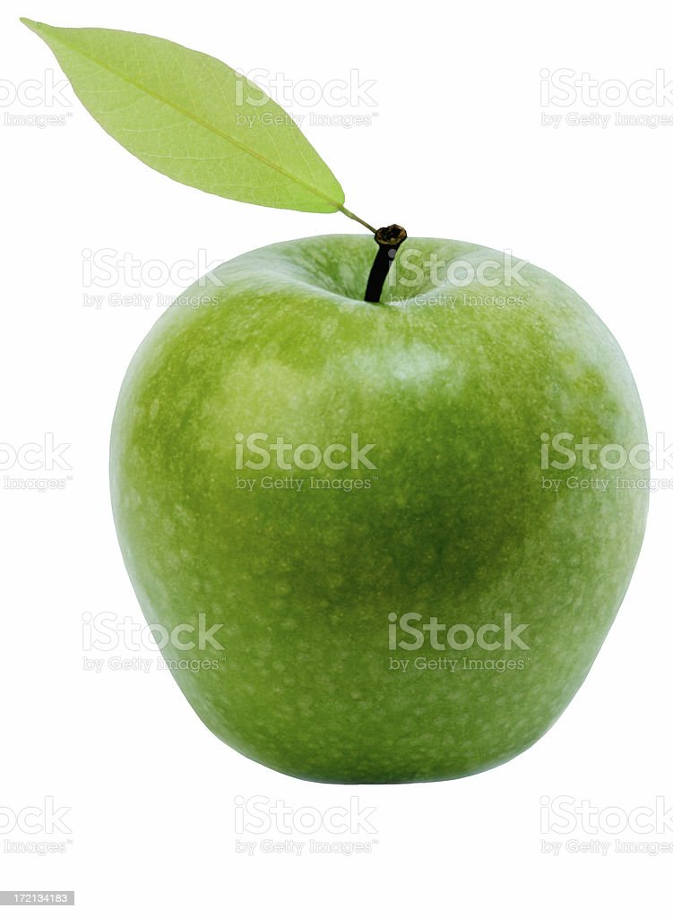 Isolated photo of a green apple with a leaf attached royalty-free stock photo