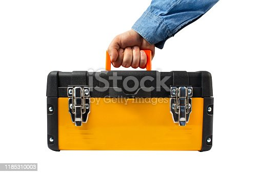 Isolated photo of a worker male hand in jeans shirt holding yellow industrial toolbox profile view on white background.