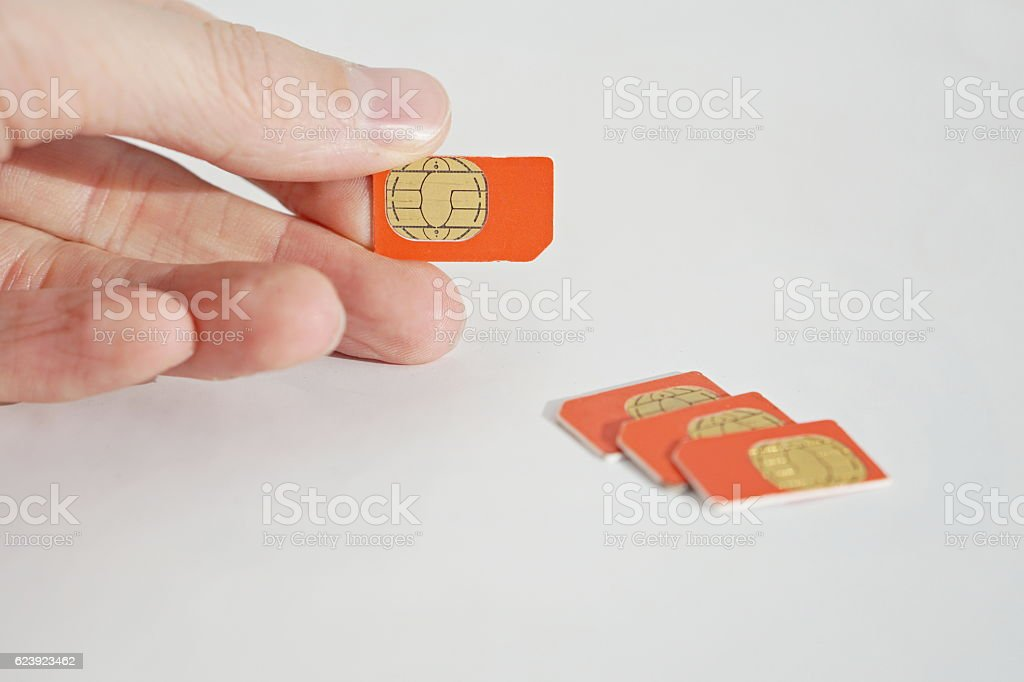Isolated photo of male hand holding red SIM stock photo