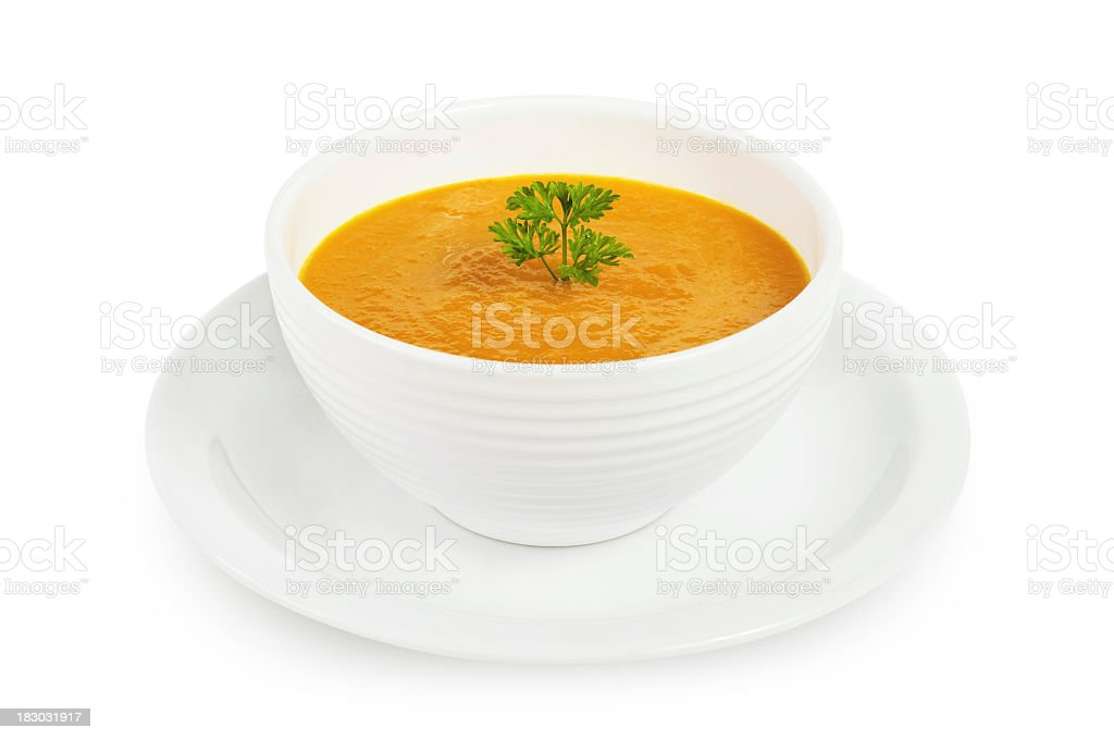 Isolated photograph of pumpkin soup in a white bowl stock photo