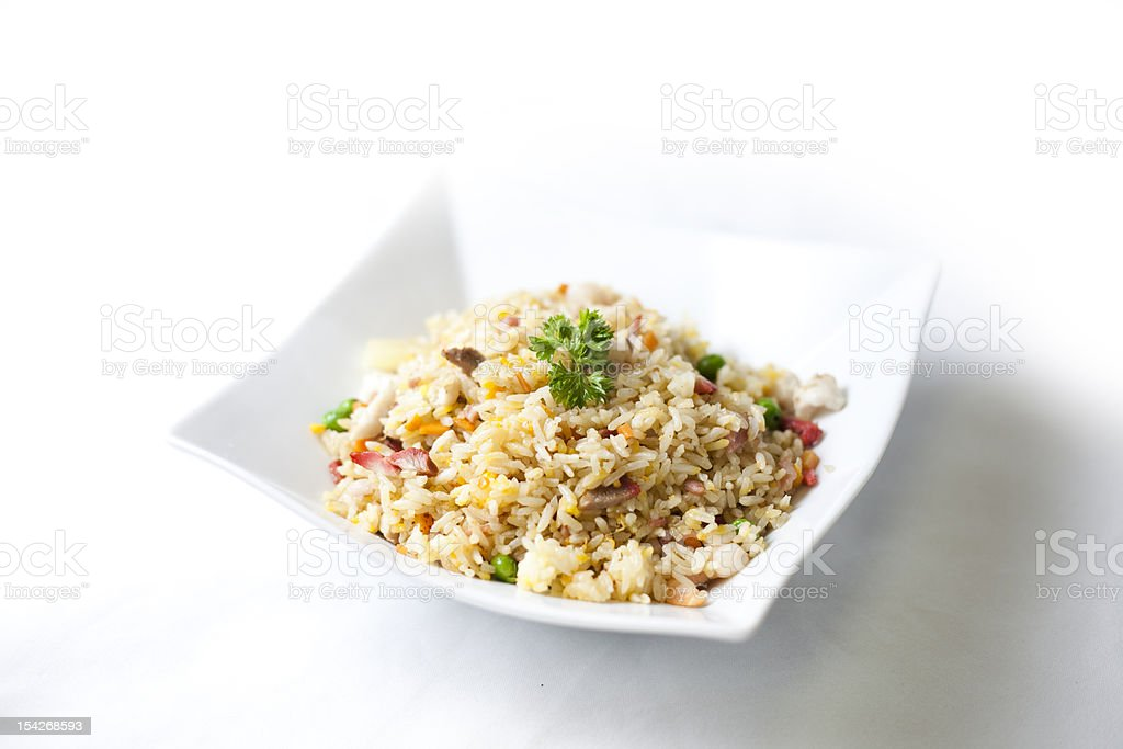 Isolated picture of Chinese fried rice in a bowl stock photo