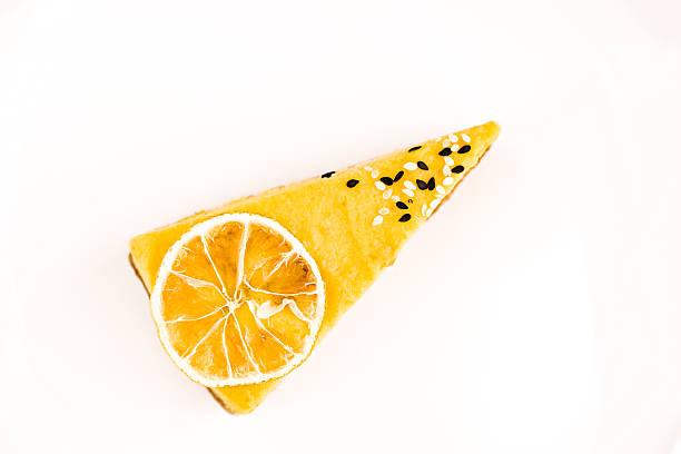 isolated piece of lemon cake on a white background - кусок торта стоковые фото и изображения