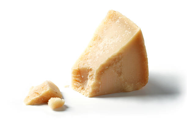 Isolated Piece of Parmesan stock photo