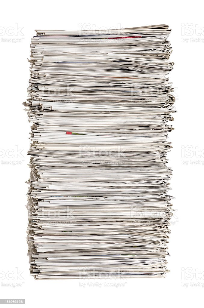 Isolated pile of newspapers on a white background stock photo