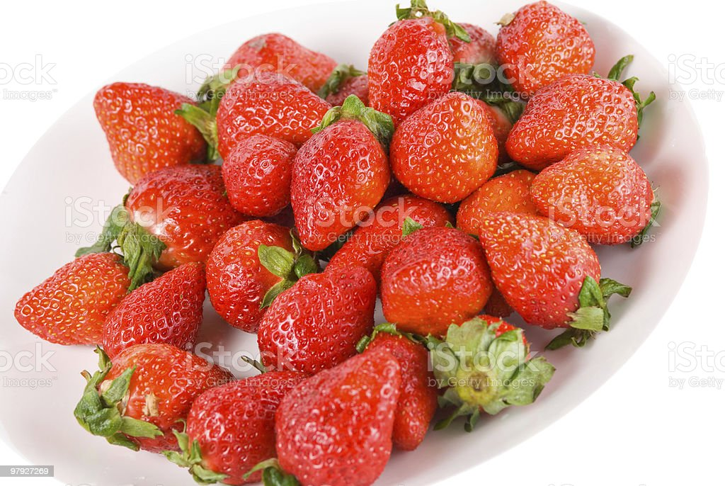 Isolated pile strawberry in white dish royalty-free stock photo