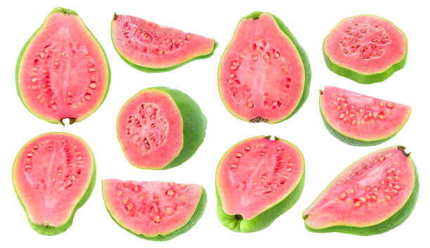 Isolated pink fleshed guava pieces Isolated guava pieces. Collection of cut green pink fleshed guava fruits of different shapes isolated on white background with clipping path guava stock pictures, royalty-free photos & images