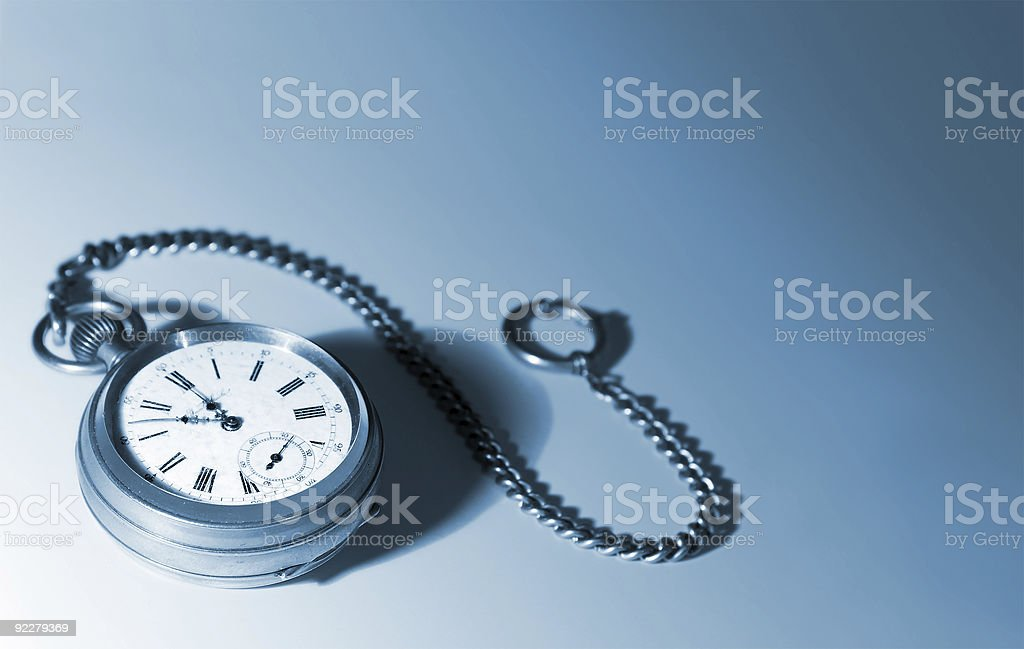 Isolated pocket watch with a chain, tinted blue stock photo