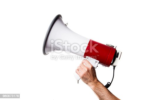 side view of a hand holding a megaphone isolated on white background