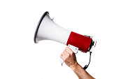 istock isolated portrait of a hand holding a megaphone 980673176