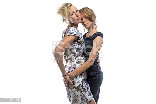 istock Isolated portrait of two standing sisters 494424136