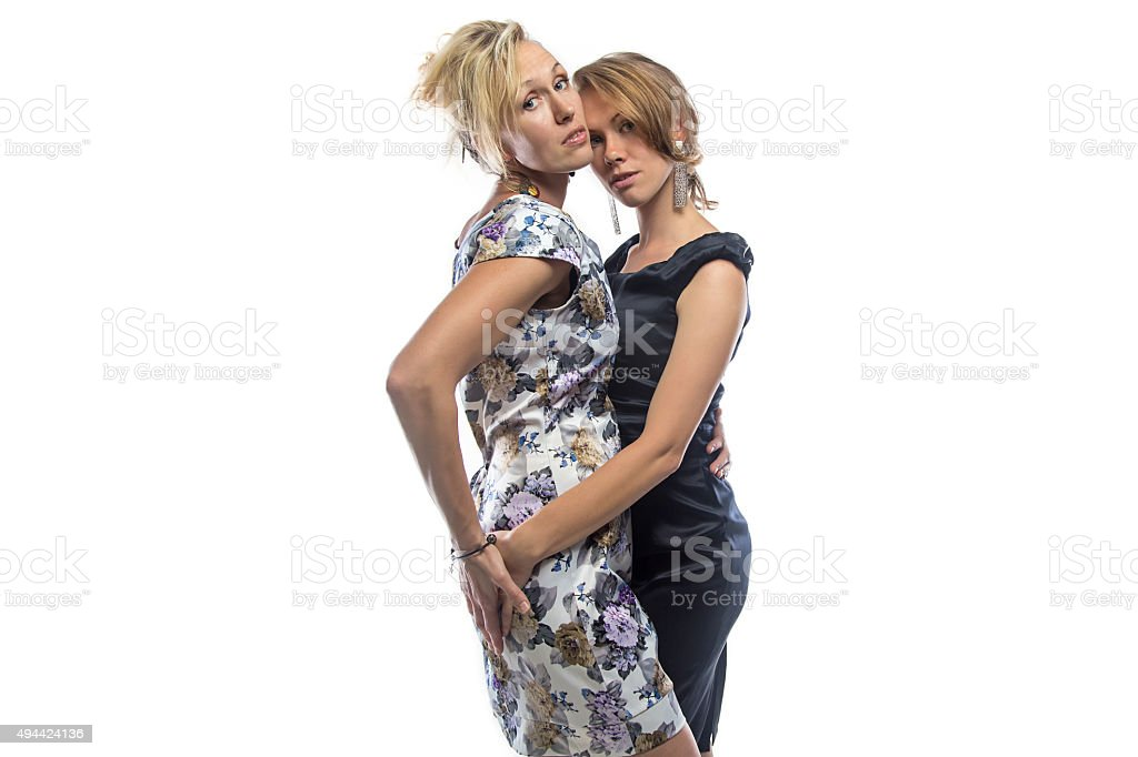 Isolated Portrait Of Two Standing Sisters Stock Photo