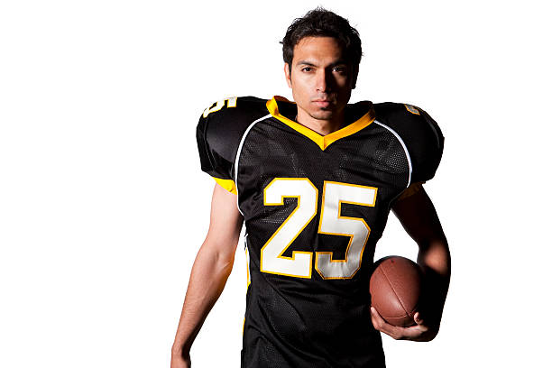 Isolated Portraits-Football Player portrait of intent high school or college athlete with black white and yellow uniform holding american football isolated on white background american football uniform stock pictures, royalty-free photos & images