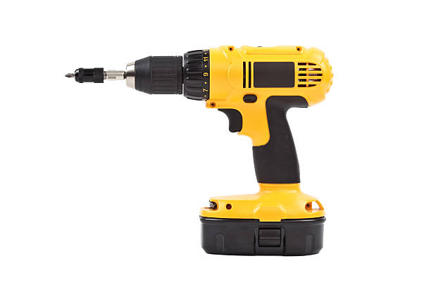 isolated power tool in yellow isolated power tool in yellow drill stock pictures, royalty-free photos & images