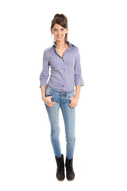 Isolated pretty woman in blue jeans and full body length. stock photo
