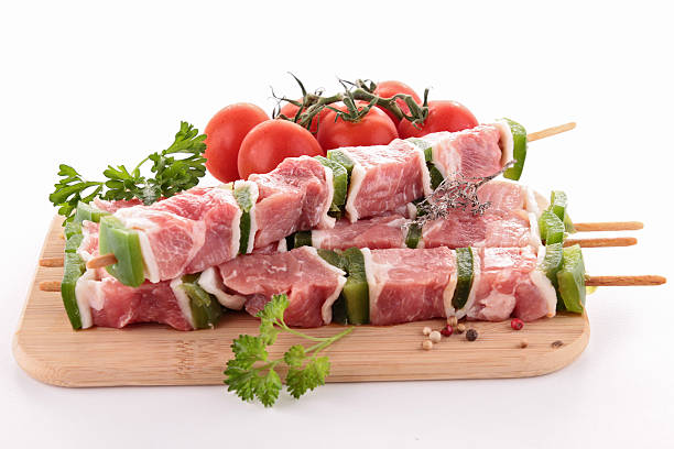 isolated raw meats on board stock photo