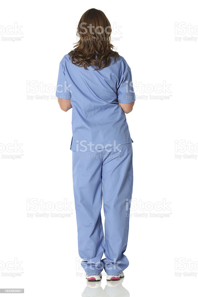 Isolated rear view of female nurse stock photo