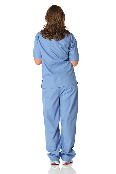 isolated rear view of female nurse - medium length hair stock photos and pictures