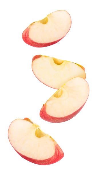 Isolated red apple pieces flying in the air stock photo