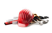 istock isolated red hard hat with tools on white 164638163