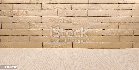 istock Isolated red-brown brick wall background and laminate flooring for display or montage your products. Header web page design concept. 1163337969