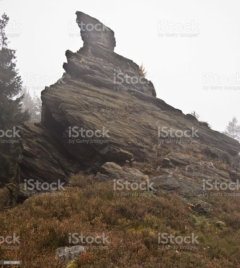 isolated rock on Vysoky kamen hill in Krusne hory mountains foto royalty-free