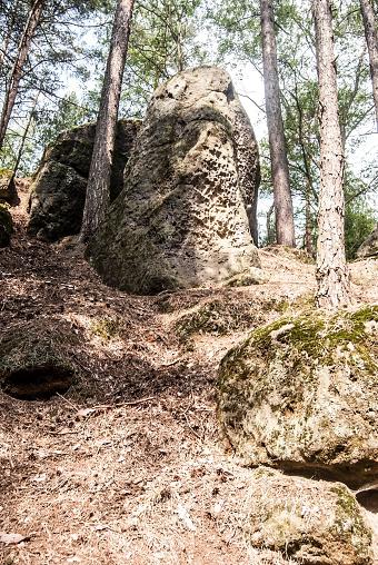 istock isolated sandstone rocks with trees around 866626846