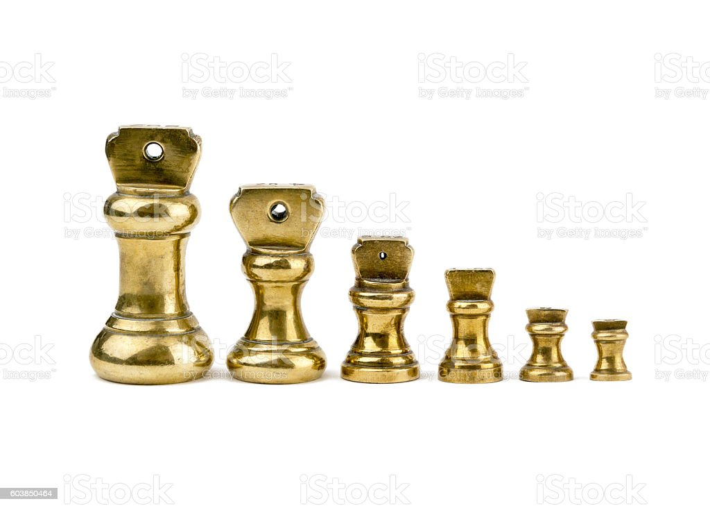 isolated set of antiques brass imperial weights stock photo
